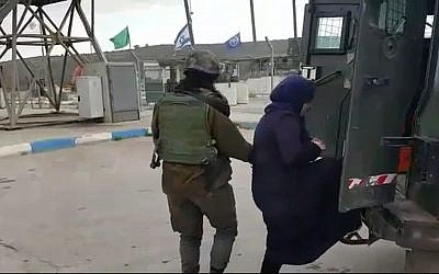 A Palestinian woman suspected of planning a stabbing attack at the West Bank's Tapuah Junction is led into a Border Police vehicle on Sunday, February 21, 2016 (screen capture: Israel Police)