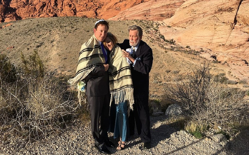Rabbi Mel Hecht marries Craig Silver and Karen Butt of Connecticut at Red Rock Canyon near Las Vegas, Feb. 12, 2016. (Ron Kampeas/JTA)
