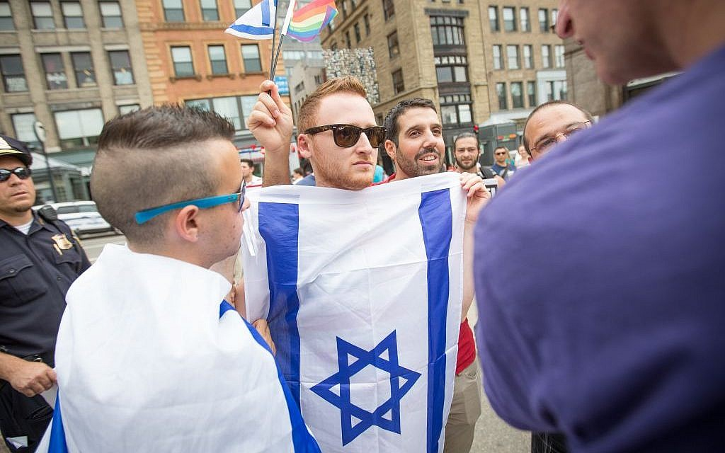 """Brett Loewenstern, center with Israeli flag, protested a Palestinian """"die-in"""" event staged on the Boston Common on July 19, 2014. (Elan Kawesch/The Times of Israel)"""
