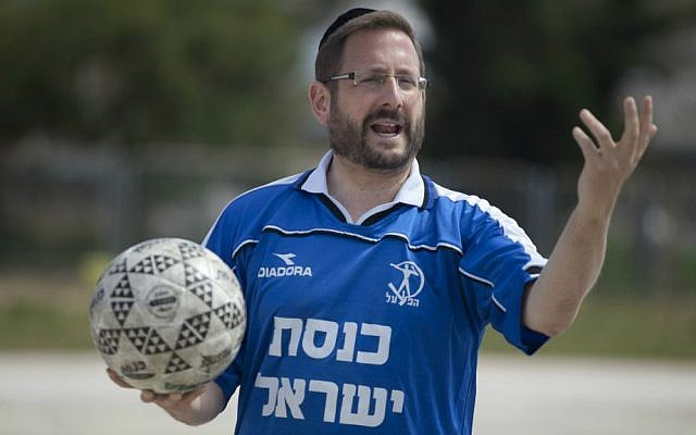 MK Dov Lipman in a Knesset jersey during a soccer training near the parliament in Jerusalem, May 13, 2014. (Flash90)
