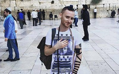 On November 20, 2015, Brett Loewenstern posed in front of the Western Wall in Jerusalem (courtesy)