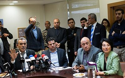 Joint (Arab) List Knesset members Jamal Zahalka (L), Hanin Zoabi (R), Basel Ghattas (2R) and Ayman Odeh (C) at the weekly faction meeting in the Knesset, February 8, 2016. (Yonatan Sindel/Flash90)
