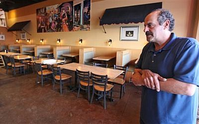 Nazareth restaurant owner Hany Baransi on Friday, Feb. 12, 2016 describes a machete attack the night before in his restaurant in Columbus, Ohio.  (Doral Chenoweth/The Columbus Dispatch via AP)