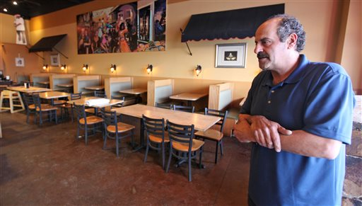 Nazareth restaurant owner Hany Baransi on Friday, February 12, 2016 describes a machete attack the night before in his restaurant in Columbus, Ohio. (Doral Chenoweth/The Columbus Dispatch via AP)