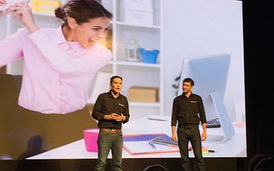 OwnBackup CEO Sam Gutmann (L) and Vice President Ori Yankelev on stage at the Microsoft Ventures Accelerator Israel Demo Day, Februeary 5, 2016 (Courtesy)