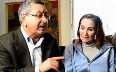 Rahat Mayor Talal al-Krenawi visits Shlomit Gonen on February 7, 2016, a day after she was stabbed in the neck in an attack in the Bedouin town's market. (screen capture: Ynet)
