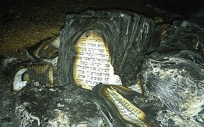 The remains of Torah scrolls set alight at the Givat Sorek outpost in the West Bank on February 6, 2016 (Courtesy: Karmei Tzur security department)