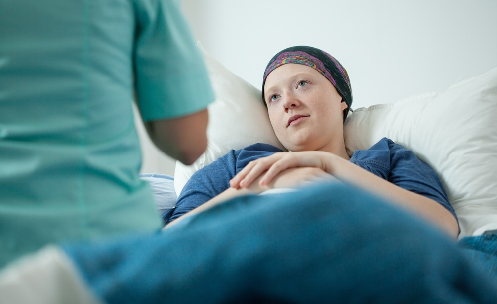 Illustrative photo of a doctor with a cancer patient (cancer patient image via Shutterstock)