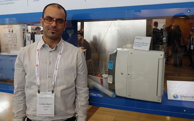 Matan Barami standing next to a Tracense system. (Courtesy)