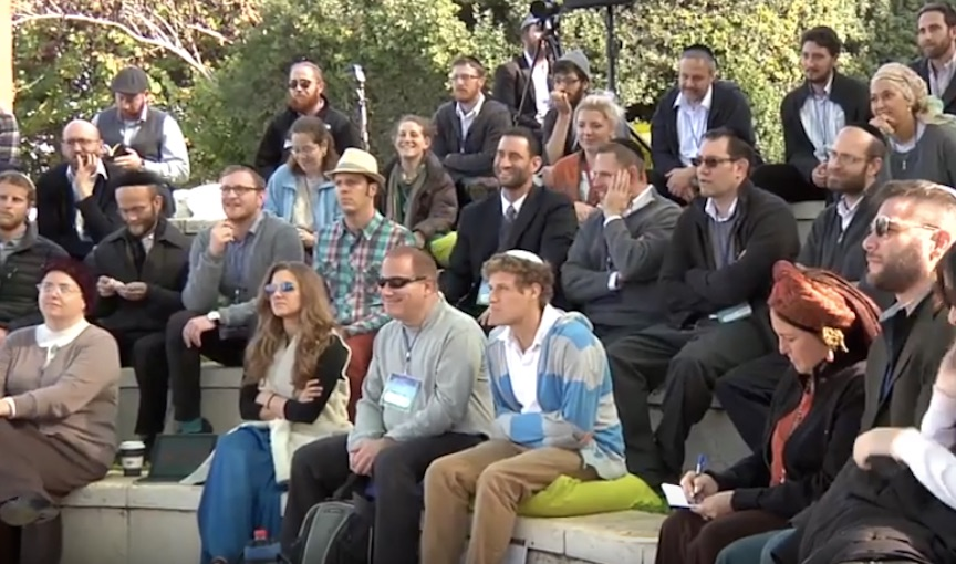 Members of the audience at a Wisdom Tribe event in the Jerusalem Forest (Courtesy)