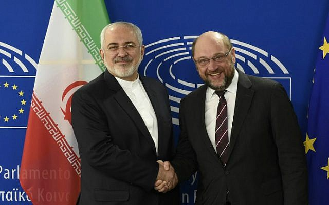 European Parliament President Martin Schulz (R) welcomes Iranian Foreign Minister Mohammad Javad Zarif prior to their meeting at the European Union headquarters in Brussels on February 16, 2016 (JOHN THYS / AFP)