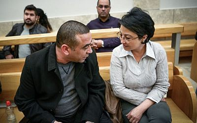Haneen Zoabi (R) sits at the courtroom in the Nazareth Magistrate's Court on February 7, 2016. (Basel Awidat/Flash90)