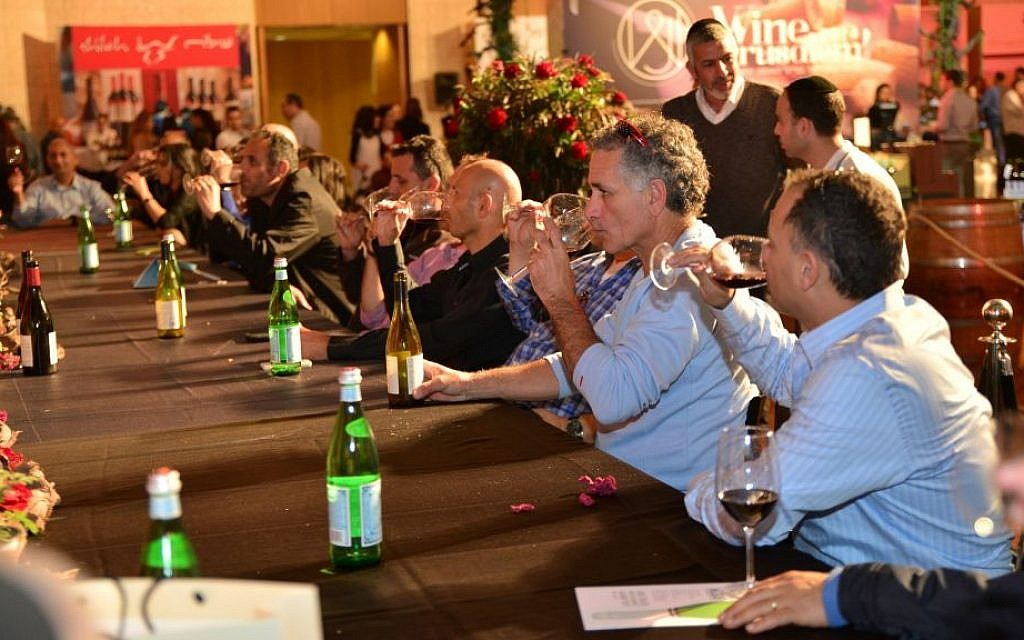 Tasting and spitting at Wine Jerusalem 2015; this year's expo opens Wednesday night at Binyanei Hauma, the International Convention Center (Courtesy Wine Jerusalem)