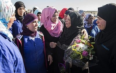 Arab-Israeli women part from a Palestinian colleague (2ndR) at SodaStream's plant in the Israeli city of Rahat in the Negev desert. She was one of the last Palestinian employees of the SodaStream drinks firm laid off following a work permit battle on February 29, 2016 (AFP / JACK GUEZ)
