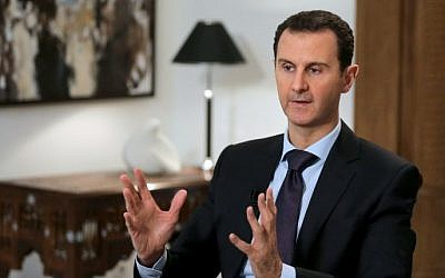 File: Syrian President Bashar Assad listening to a question during an interview with AFP in the capital Damascus, February 11, 2016. (AFP/JOSEPH EID)