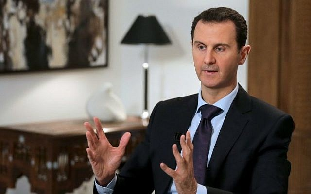 Syrian President Bashar al-Assad listening to a question during an interview with AFP in the capital Damascus, February 11, 2016. (AFP/JOSEPH EID)