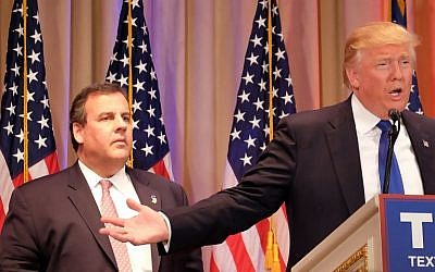 New Jersey Governor and former White House hopeful Chris Christie (left) listens as Republican presidential candidate Donald Trump (right) speaks to the media in Palm Beach, Florida, March 1, 2016. (AFP/Gaston De Cardenas)
