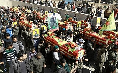 Mourners carry the coffins of fighters from the Kurdish People's Protection Units' (YPG), after they were killed in combat against Islamic State (IS) group jihadists in the town of Tal Abyad on the border with Turkey, during their funeral in the Syrian town of Ras al-Ain, on March 2, 2016. (Delil Souleiman/AFP)