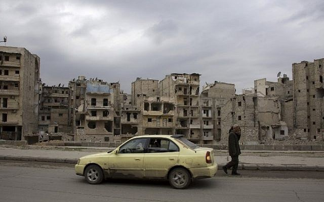 Ayoub, a 27-year-old Syrian man, drives his taxi on a street in the rebel-controlled side of Aleppo on March 3, 2016 (AFP / KARAM AL-MASRI)