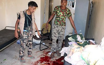 Yemeni pro-government fighters inspect an elderly care home in Yemen's main southern city of Aden after it was attacked by gunmen on March 4, 2016, killing 16 people. (AFP/SALEH AL-OBEIDI)