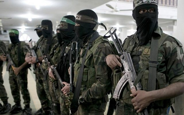 Hamas members at a funeral in the southern Gaza Strip on March 4, 2016. (AFP/SAID KHATIB)