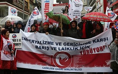 Turkish members of labor unions and civil society groups shout slogans before upcoming International Women's Day in Ankara on March 5, 2016. The banner reads: 'March for Peace and Secularism against Imperialism.' (Adem Altan/AFP)