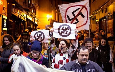 People take part in an anti extreme right rally in reaction to results of parliamentary elections in Bratislava on March 7, 2016.  The neo-Nazi People's Party Our Slovakia (LSNS) led by Marian Kotleba gained 8 percent of the votes. (AFP / VLADIMIR SIMICEK)