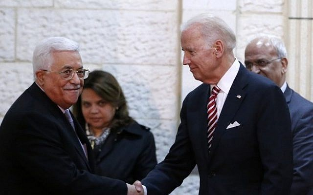 US Vice President Joseph Biden shakes hands with Palestinian President Mahmoud Abbas during a meeting in the West Bank city of Ramallah, March 9, 2016. (AFP/Abbas Momani)