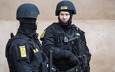 Illustrative: Danish policemen stand guard in front of the city court in Copenhagen, Denmark, on March 10, 2016. (AFP/SCANPIX DENMARK/Emil Hougaard)