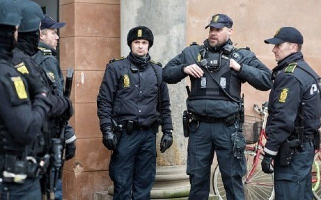 Illustrative: Danish policemen stand guard in front of the city court in Copenhagen, Denmark, where a trial is to open on March 10, 2016 against four men accused of helping a Danish-born gunman whose attacks on a synagogue and a free speech event  left two people dead. (AFP/SCANPIX DENMARK/Emil Hougaard)