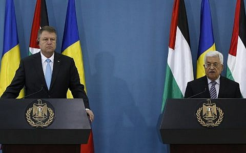 Palestinian Authority President Mahmoud Abbas (R) and Romanian President Klaus Iohannis during a joint press conference in the West Bank city of Ramallah on March 10, 2016. (AFP/Abbas MomaniI)