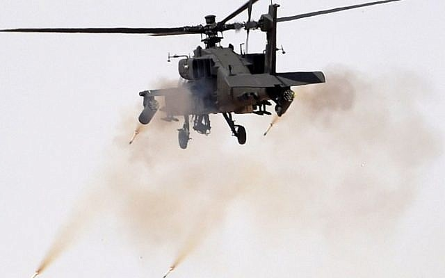 Illustrative: An Apache helicopter firing during a military exercise in Hafr al-Batin, Saudi Arabia on March 10, 2016. (AFP/Fayez Nureldine)