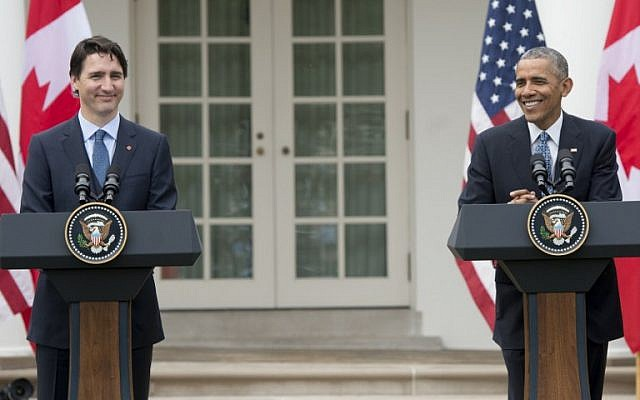 US President Barack Obama and Canadian Prime Minister Justin Trudeau hold a joint press conference in the Rose Garden of the White House in Washington, DC, March 10, 2016, as part of a State Visit. (AFP/SAUL LOEB)