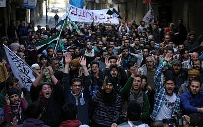 Protesters shout slogans during an anti-regime demonstration in the rebel-controlled Sukkari neighborhood of Syria's northern city of Aleppo on March 11, 2016 (AFP / KARAM AL-MASRI)