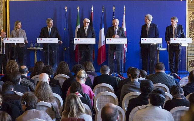From left: The EU Foreign Policy chief Federica Mogherini, Italian Foreign Minister Paolo Gentiloni, German Foreign Minister Frank-Walter Steinmeier, French Foreign Minister Jean-Marc Ayrault, US Secretary of State John Kerry and British Foreign Secretary Philip Hammond speak following a meeting between the US and its European allies on the situations in Libya, Syria, Ukraine and Yemen, in Paris, France, March 13, 2016. The United States and France warned the Syrian regime on Sunday against trying to disrupt the fragile ceasefire as the warring sides prepared for fresh peace talks to end the brutal five-year conflict. / AFP / GEOFFROY VAN DER HASSELT