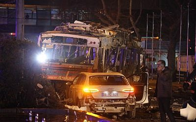 The wreckage of a bus and a car are pictured at the scene of a blast in Ankara on March 13, 2016. (AFP/Erol Ucem)