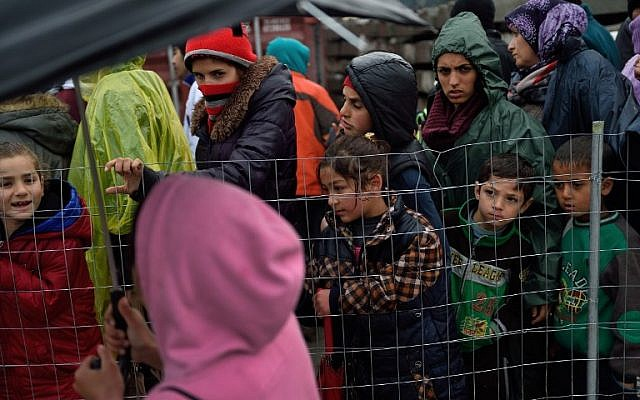 Migrants queue for free food at a makeshift camp at the Greek-Macedonian border, near the Greek village of Idomeni on March 15, 2016, where thousands of refugees and migrants are stranded by the Balkan border blockade.(AFP / DANIEL MIHAILESCU)