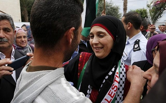 Hanan al-Hroub, a Palestinian teacher who won the $1 million Global Teacher award is welcomed during a public reception in the West Bank city of Jericho on March 16, 2016. (AFP / ABBAS MOMANI)