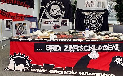 A photo taken on March 2, 2012 shows neo-nazi flags, masks, weapons and a giant banner reading 'BRD zerschlagen! WWT Sektion Hamburg' (Disintegrate Federal Republic of Germany! WWT Section Hamburg) displayed during a press conference in Hamburg, northern Germany.   (AFP / dpa / Malte Christians)