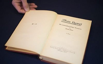 A copy of Nazi leader Adolf Hitler's political manifesto Mein Kampf, discovered at his Munich apartment and signed by eleven American officers, is on display March 18, 2016 before auction at Alexander Historical Auctions in Chesapeake City, (Jim Watson/AFP)