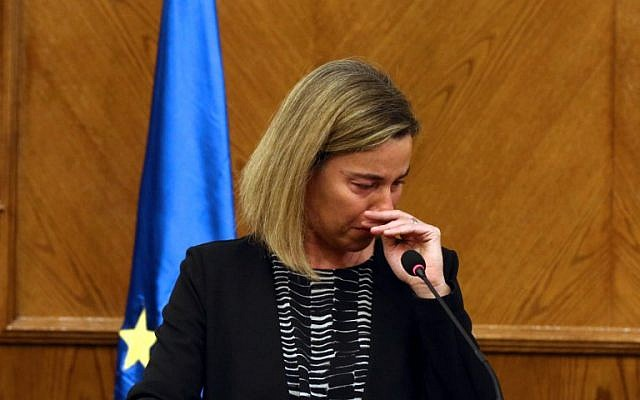 EU foreign policy chief Federica Mogherini cries during a joint press conference with Jordanian Foreign Minister in the capital Amman, on March 22, 2016, upon receiving the news about a string of explosions that rocked Brussels airport and a city metro station. (str / AFP)