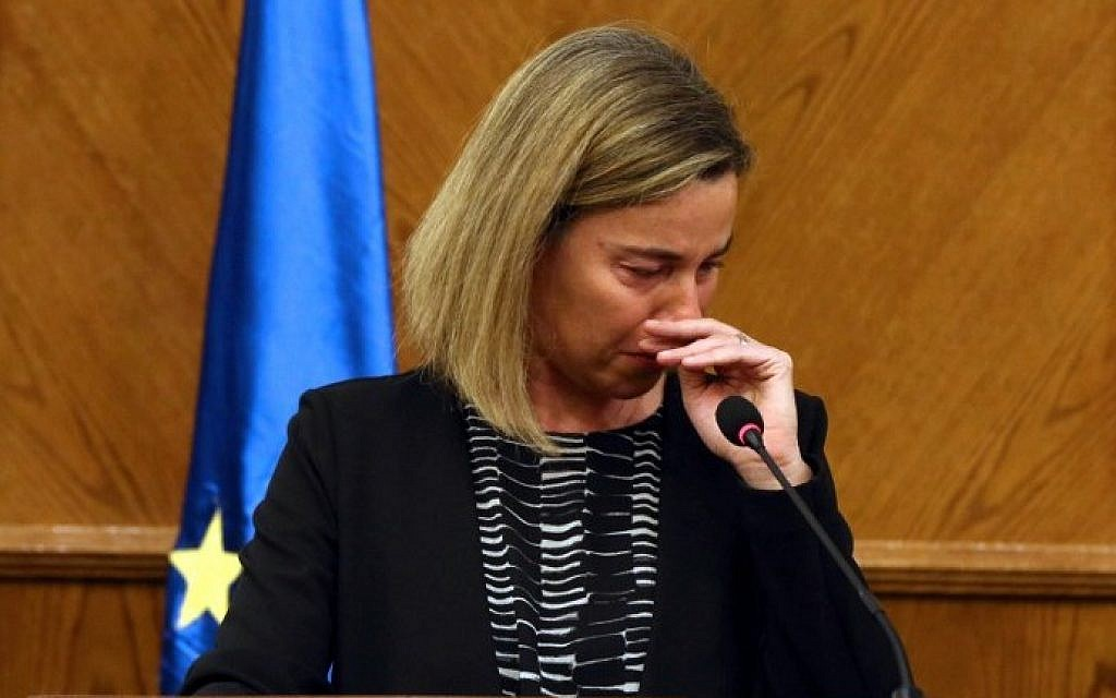 EU foreign policy chief Federica Mogherini reacts during a joint press conference with Jordanian Foreign Minister in the capital Amman, on March 22, 2016, upon receiving the news about a string of explosions that rocked Brussels airport and a city metro station. (AFP / str)
