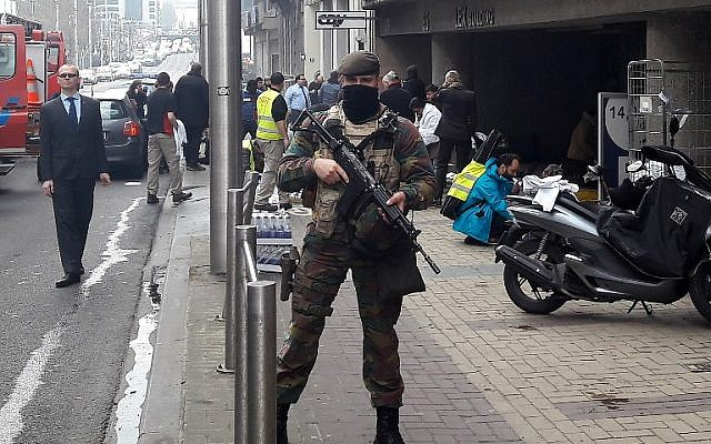 A Belgian soldier stands guard outside the Maalbeek metro station in Brussels on March 22, 2016 after a blast killed at least 15 people. (AFP/Cédric SIMON)