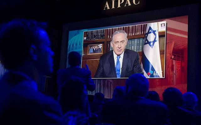 Israeli Prime Minister Benjamin Netanyahu speaks via a satellite feed during the American Israel Public Affairs Committee 2016 Policy Conference at the Washington Convention Center in Washington, DC, March 22, 2016. (AFP / SAUL LOEB)