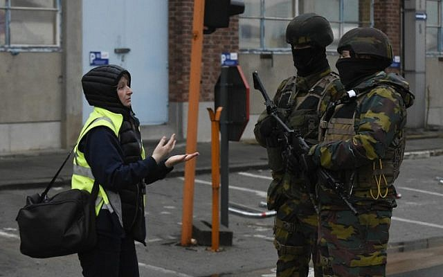 Belgian soldiers stand guard near Brussels airport in Zaventem on March 23, 2016 a day after terror attacks hit the city. (AFP / JOHN THYS)