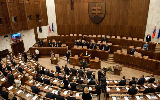 Deputies stand after Slovak Prime Minister-elect and leftist Smer-Social Democracy party leader Robert Fico took the oath of office on the Slovak Constitution, March 23, 2016. (AFP/SAMUEL KUBANI)