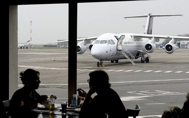 A Brussels Airlines plane is seen on the tarmac of Ostende airport, on March 24, 2016, in Ostend, two days after a triple bomb attack hit Brussels' airport and the Maelbeek subway station, killing 31 people and wounding 300 others. (AFP/Belga/Dirk Waem)