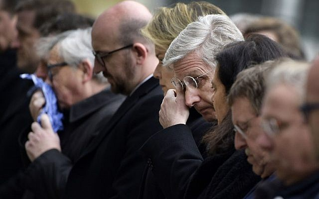 (From L) European Commission President Jean-Claude Juncker, Belgian Prime Minister Charles Michel and King Philippe of Belgium react before observing a minute of silence on March 24, 2016 at the Federal Parliament in Brussels, two days after a triple bomb attack in the city killed 31 people. (AFP/Belga/YORICK JANSENS)