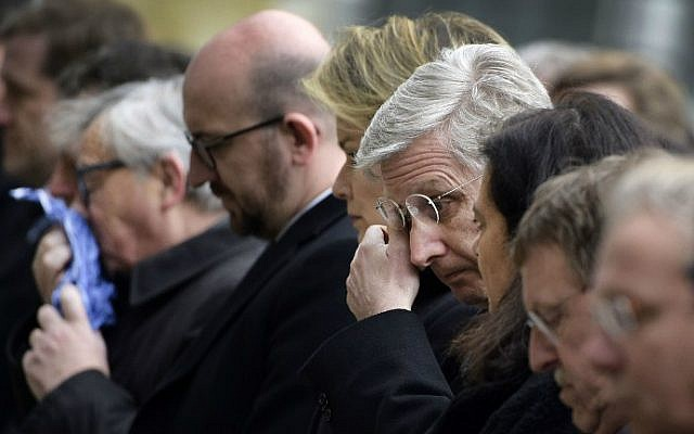 (From L) European Commission President Jean-Claude Juncker, Belgian Prime Minister Charles Michel and King Philippe of Belgium react before observing a minute of silence on March 24, 2016 at the Federal Parliament in Brussels, during a homage ceremony for victims two days after a triple bomb attack claimed by the Islamic State group hit Brussels's airport and the Maalbeek metro station, killing 31 people and wounding 270 others. (Yorick Jansens/Belga/AFP)