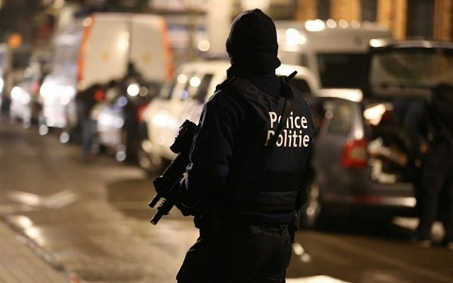 A police officer takes part in an operation in Brussels, late on March 24, 2016. (AFP/Belga/Nicolas Maeterlinck)